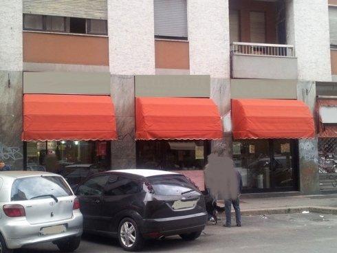 cappottine vetrine negozio arancio
