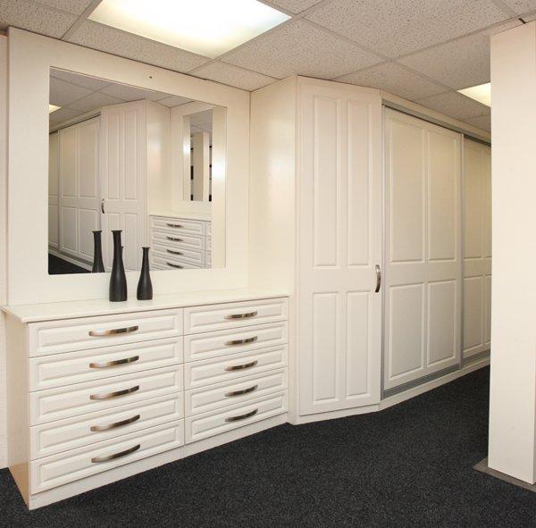 A built-in sliding wardrobe