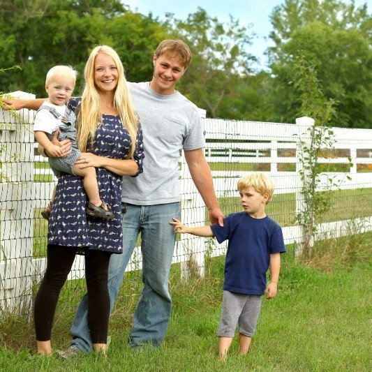 Family in front of fences in White Oak, OH