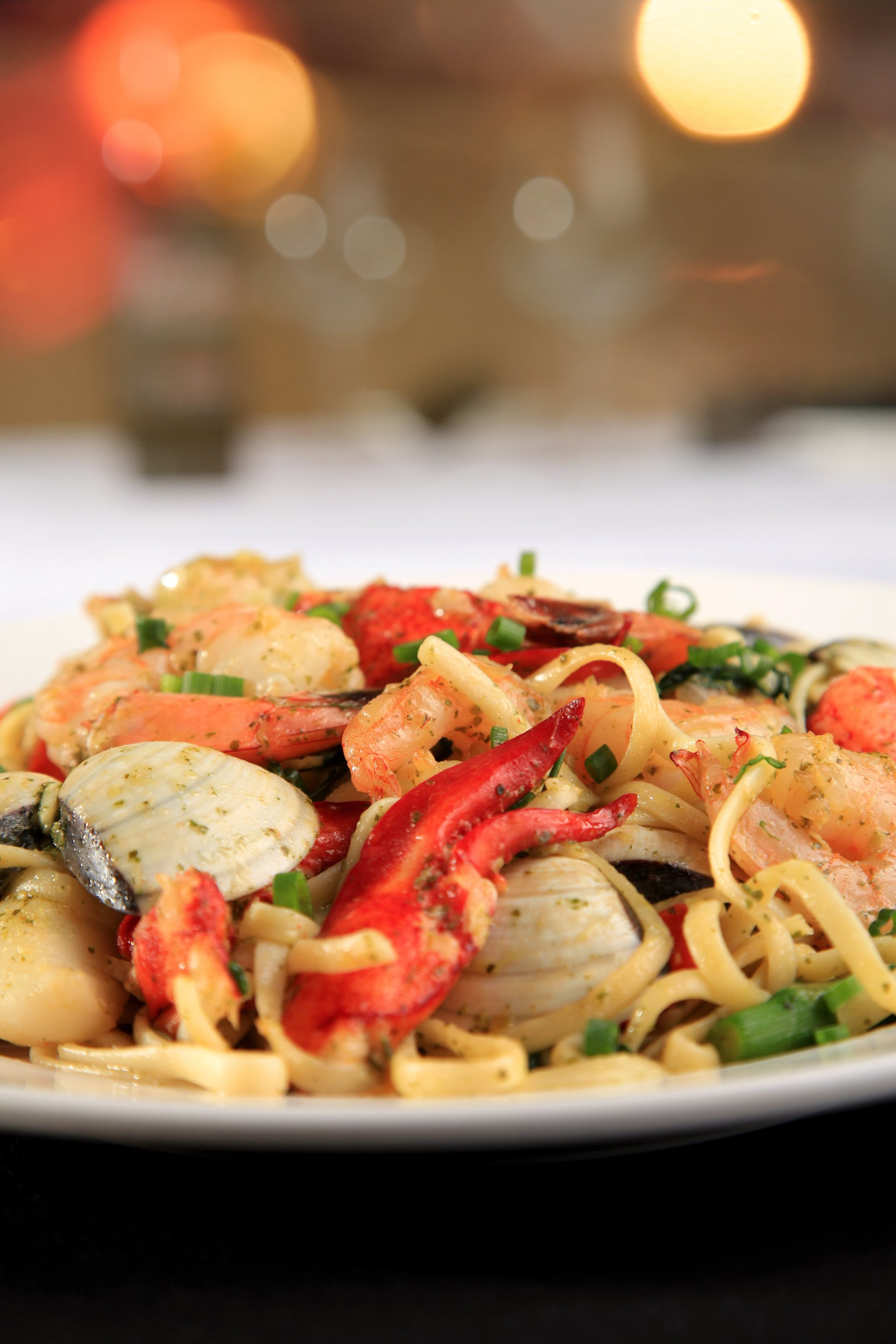 Linguine Pescatore - Shrimp scallops clams and lobster, sautéed with peppers and spinach, with olive oil and hint of pesto.