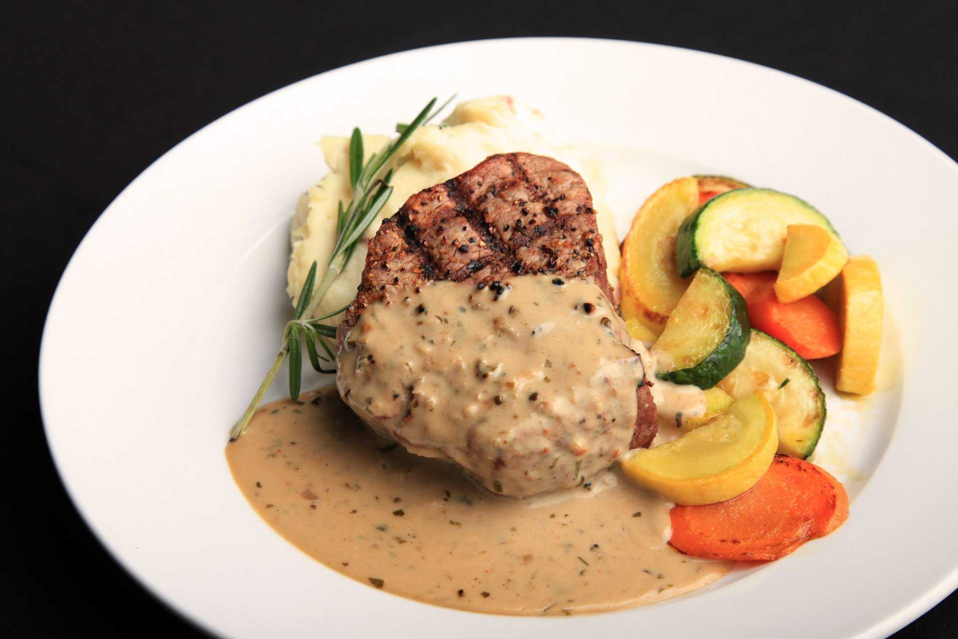 Ti Amo filet topped with your choice of Romano or brandy peppercorn cream sauce.