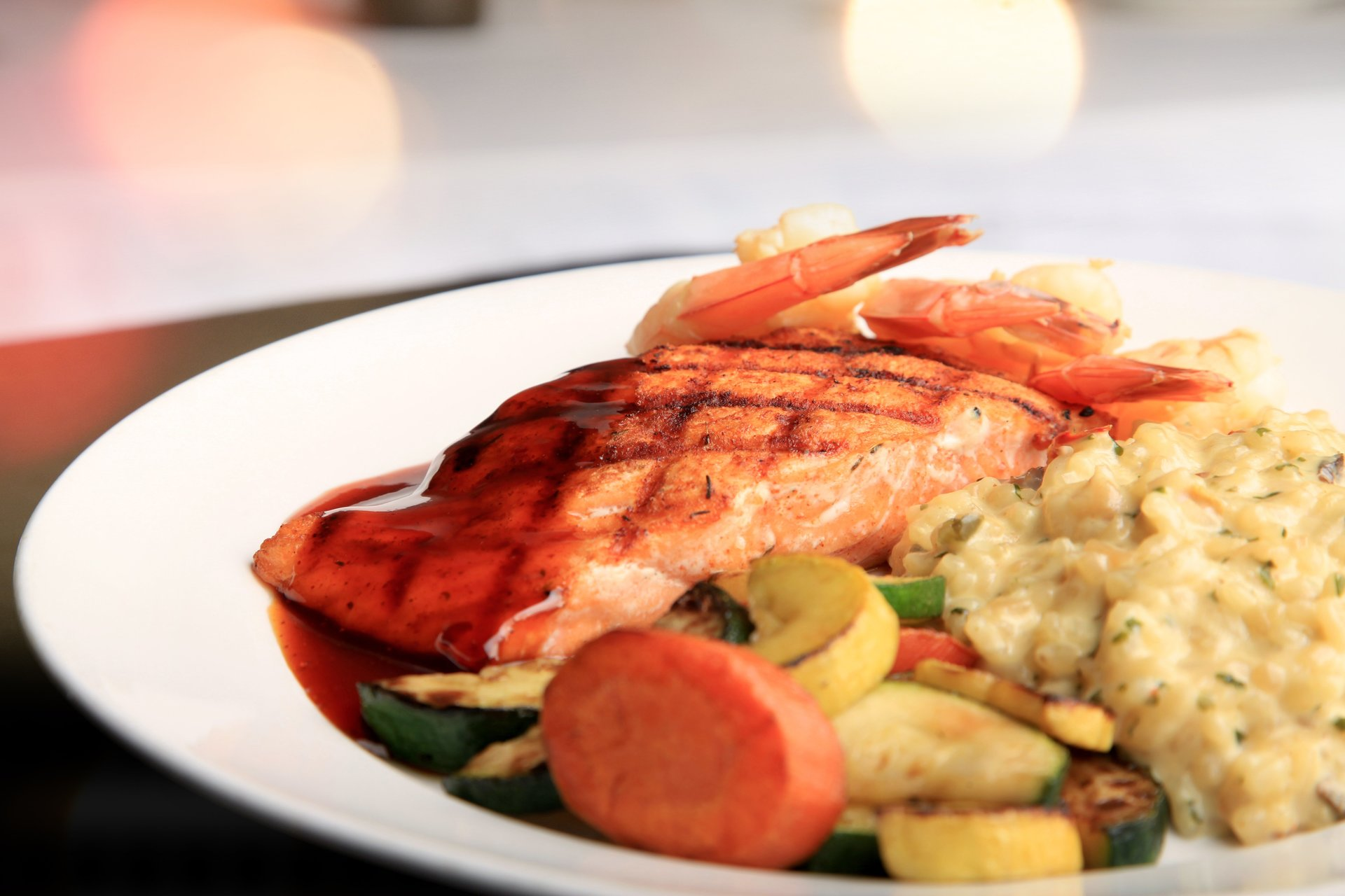 Grilled Salmon - Topped with your choice of bourbon sauce or shrimp, lemon butter garlic sauce.