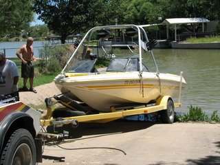 Towing company providing assistance to pull boat out of the water