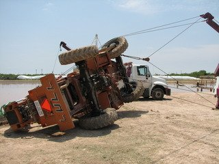 Towing company assisting with machinery & tractor trailer towing