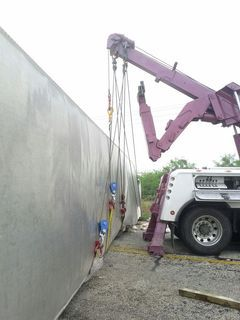Towing company lifting a tractor trailer