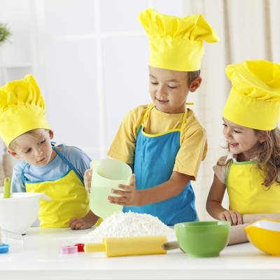 three children cooking