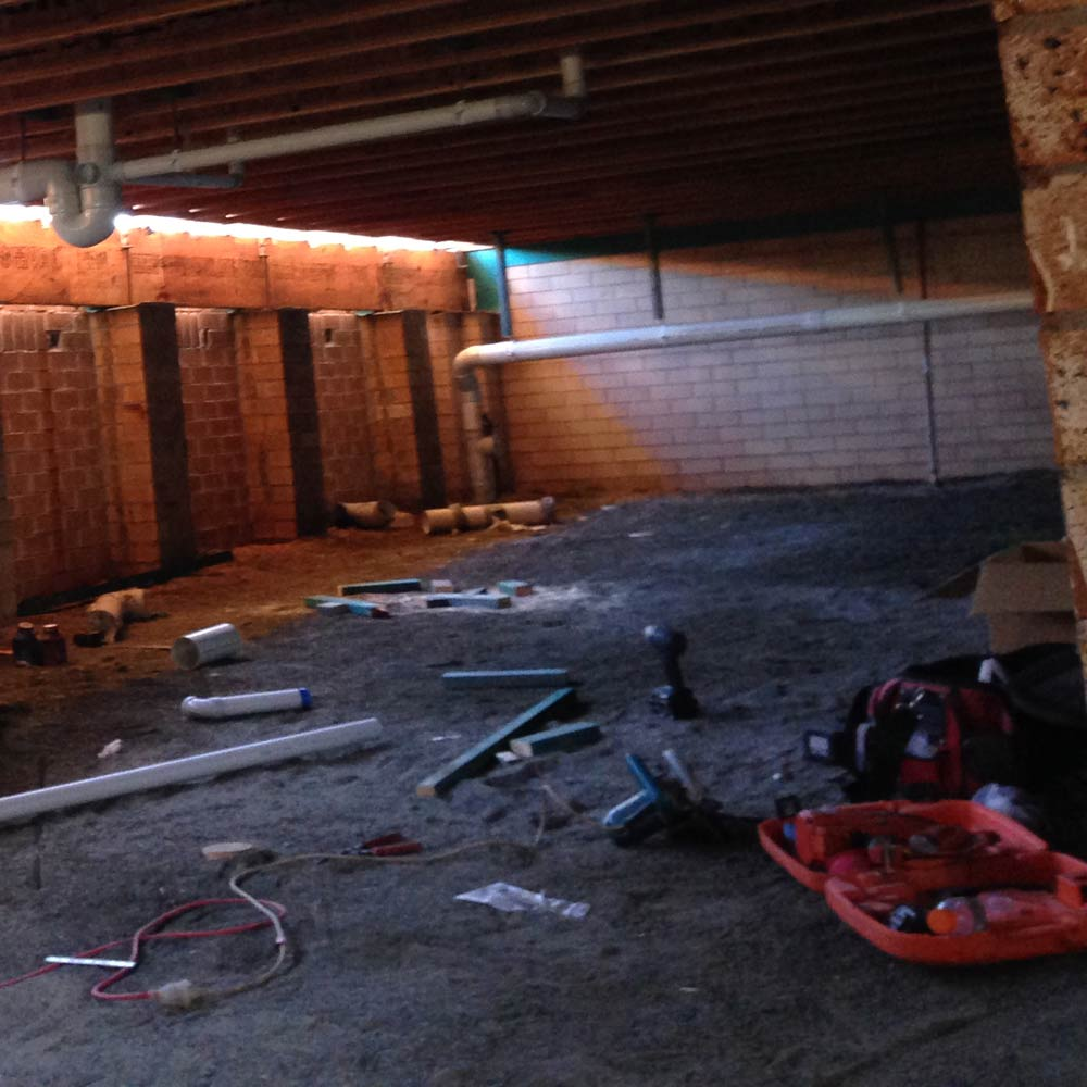 tools laid out in basement being maintained