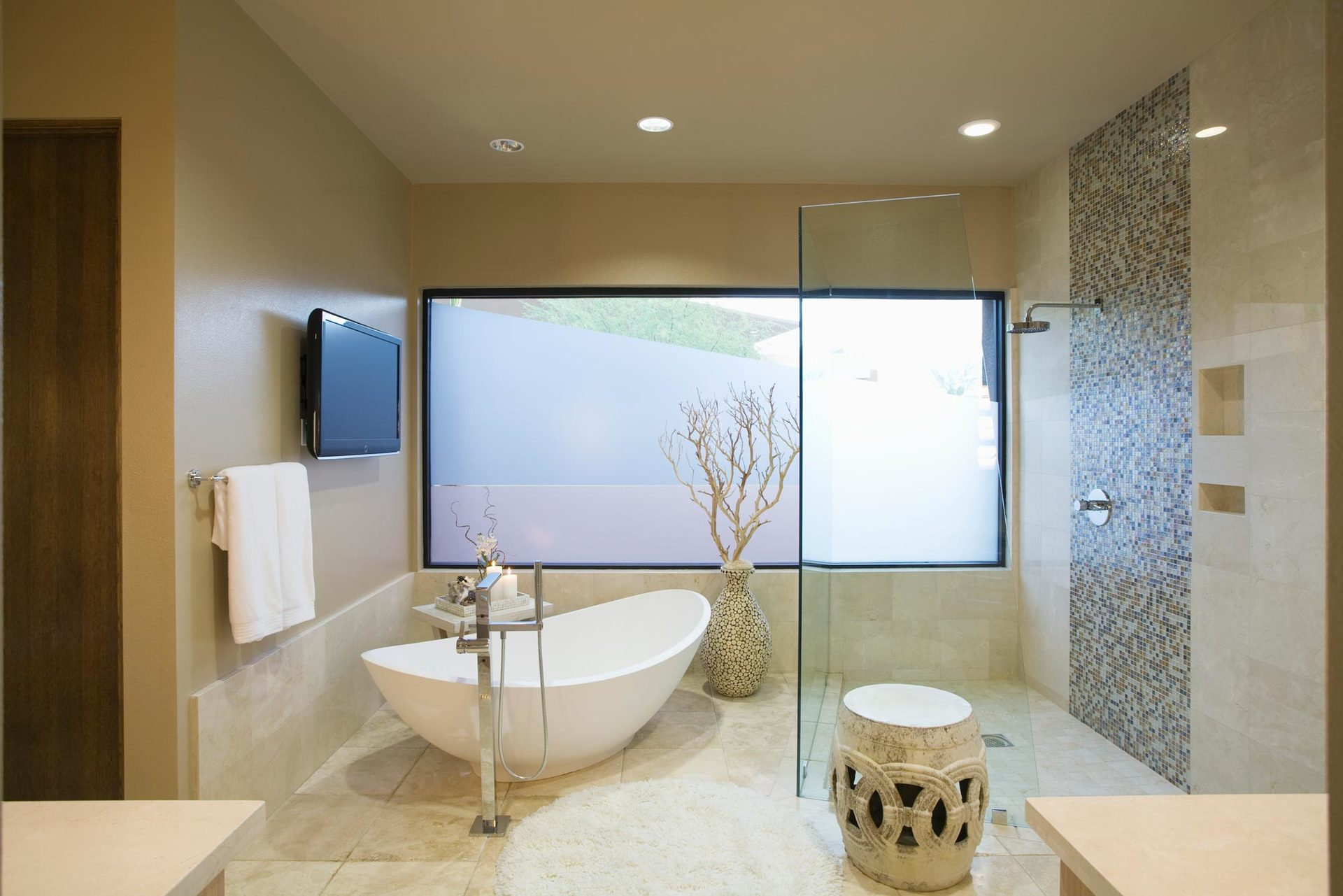 modern bathroom with tree and free standing tub