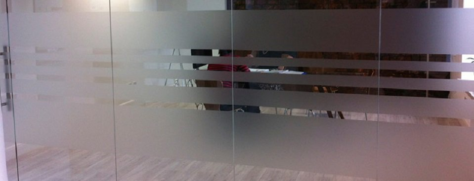 Frosted glass window stickers on an internal glass wall