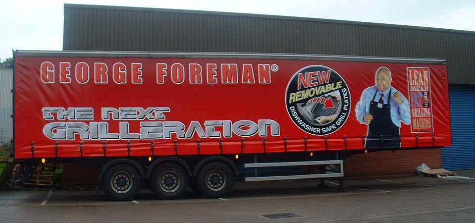 A printed banner on the side of a lorry