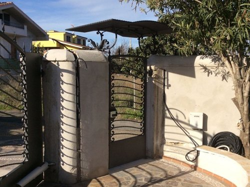cancello per esterno in ferro battuto