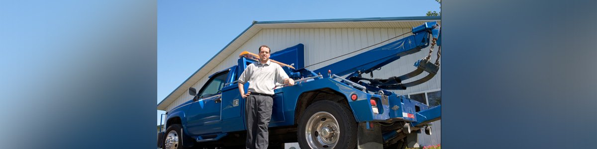 hills towing and crash repairs services towing  car and man