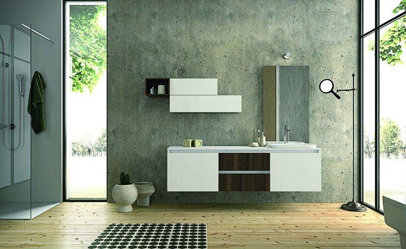 un mobile da lavabo e due mensole di color bianco