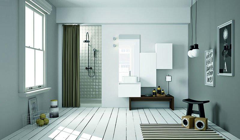 un bagno con una doccia di color nero e dei mobili a muro di color bianco