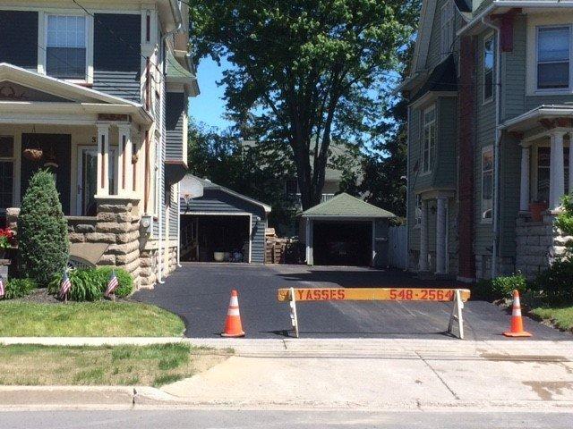 New asphalt driveway installation