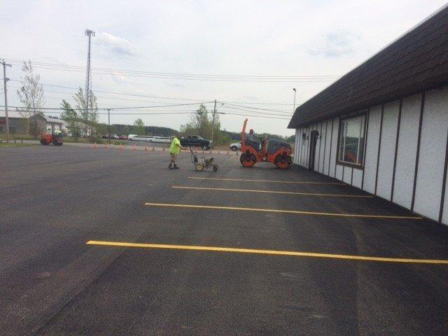 Man working on a parking lot sealing job in Batavia, NY