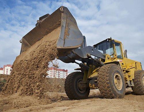 Excavating contractor hauling dirt materials in Batavia, NY