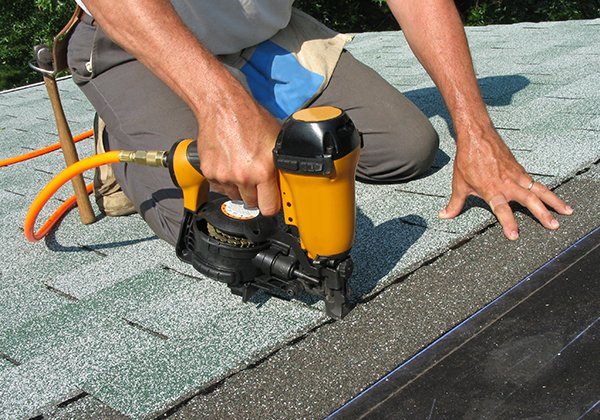 Carpenter asphalt shingles to roof