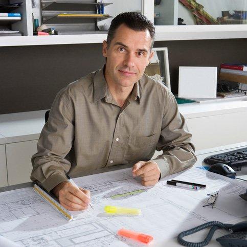 man designing on paper