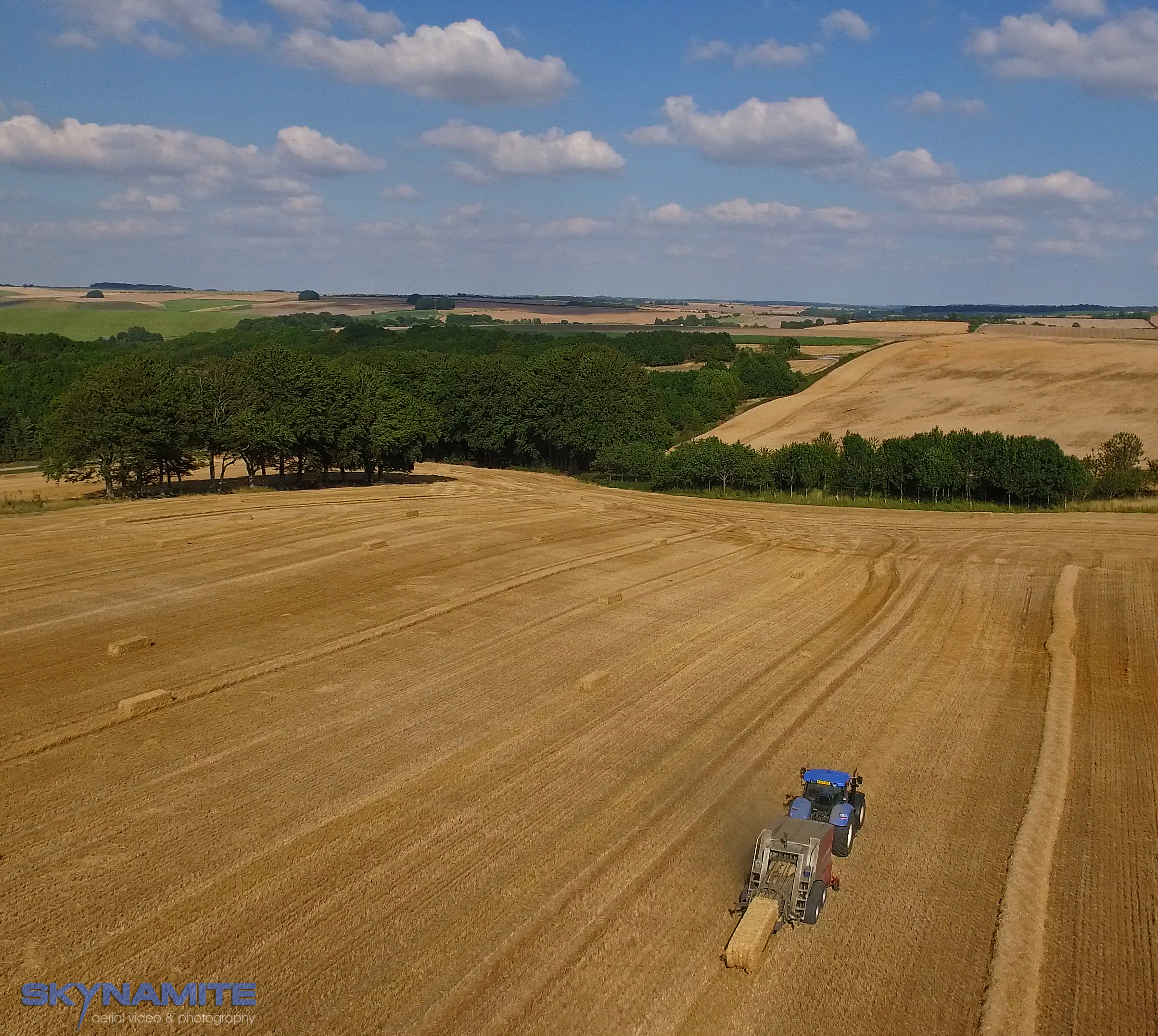 Aerial harvesting picture with tractor