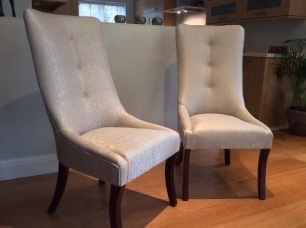 Two contemporary cream coloured chairs