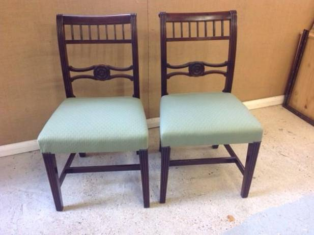 Two dining chairs with green seats