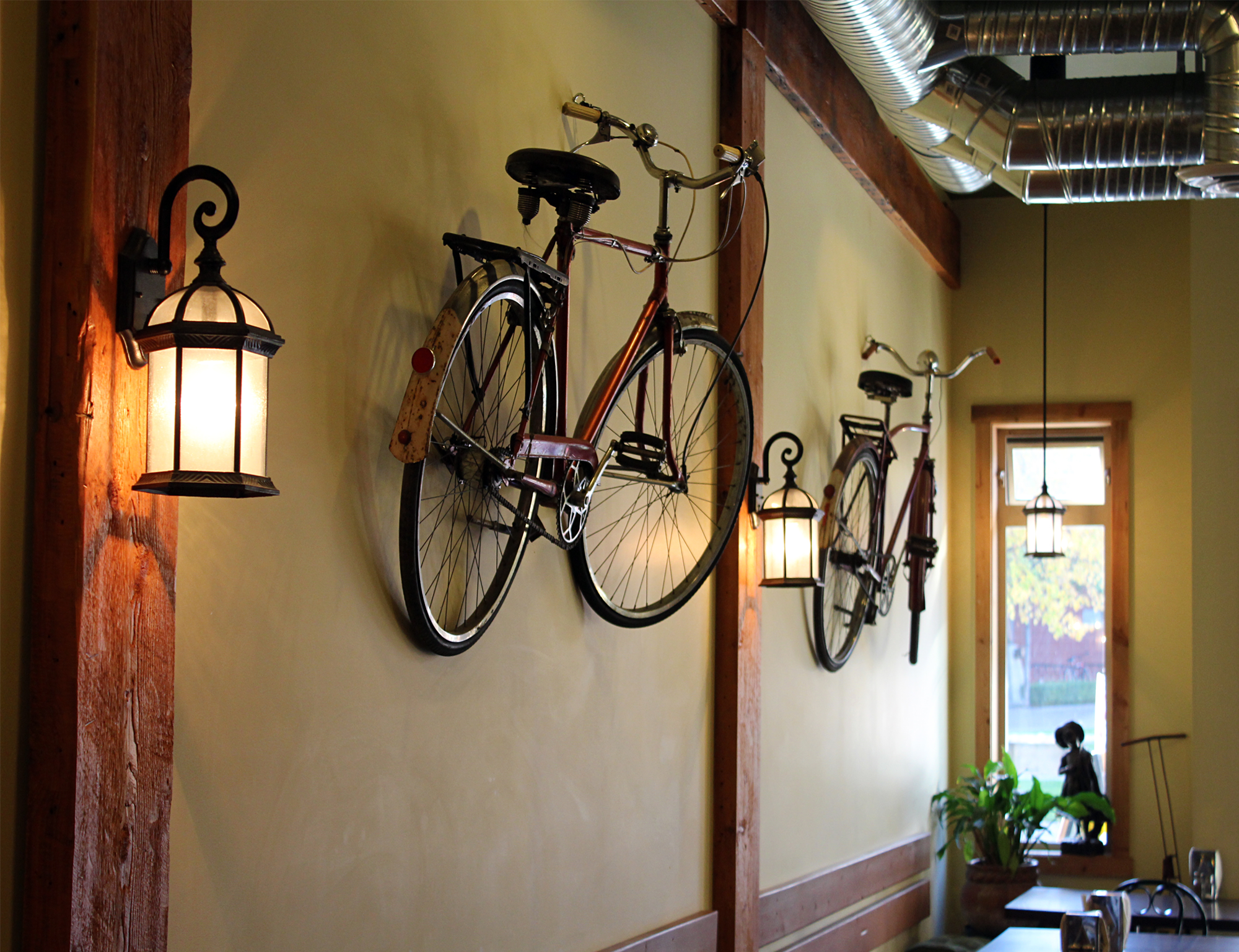 Bicycles on the wall in the inside of the restaurant