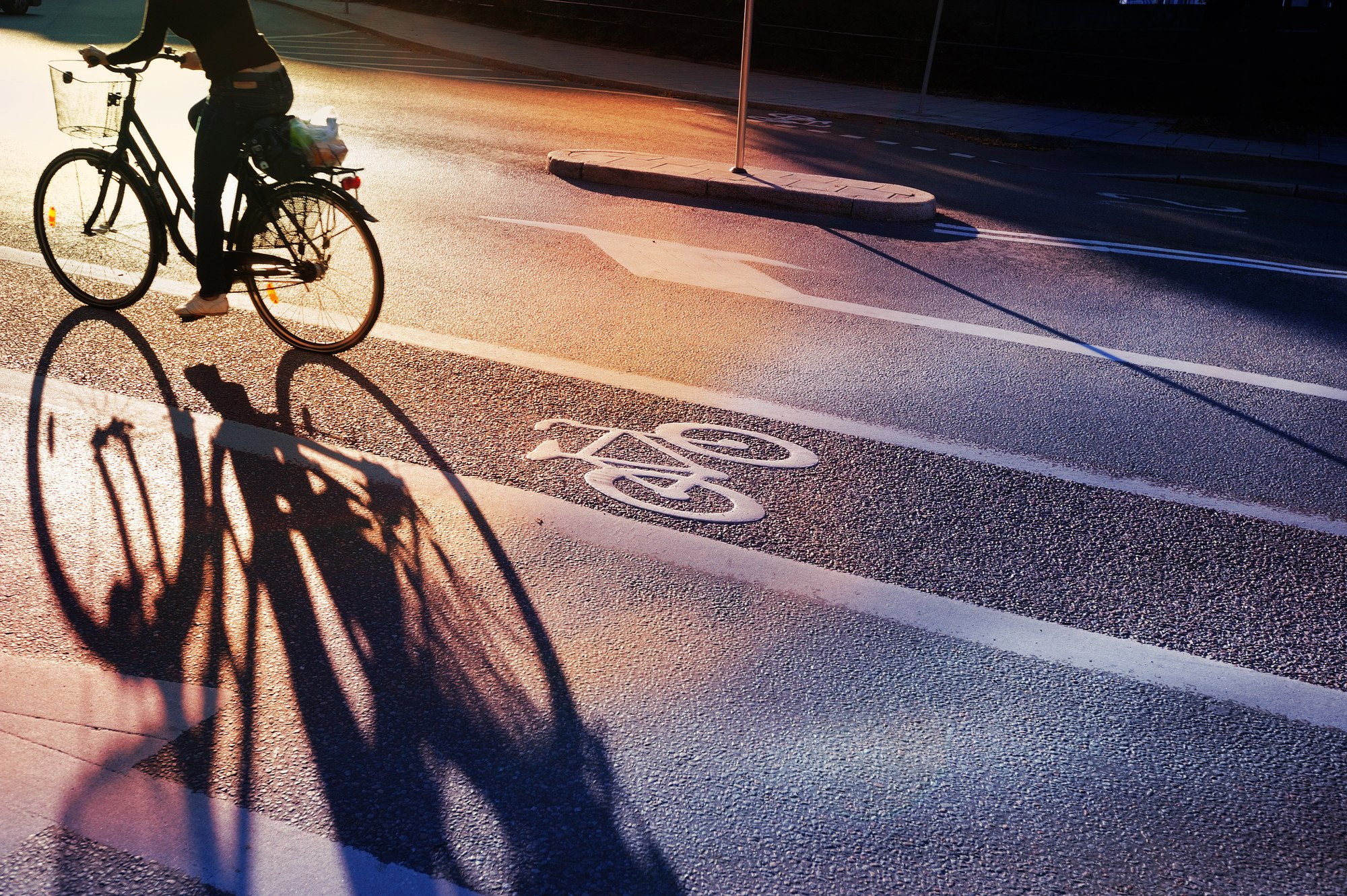 A cyclist cycling down a road