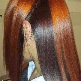 una donna con capelli lisci neri e arancioni