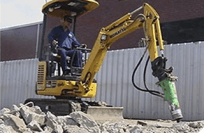Man using a mini excavator in Perth