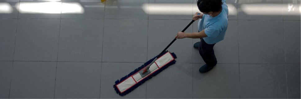 Man mopping a floor in Plymouth