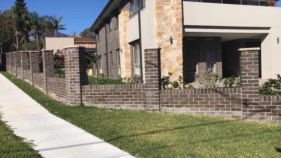 brick trimmed fence