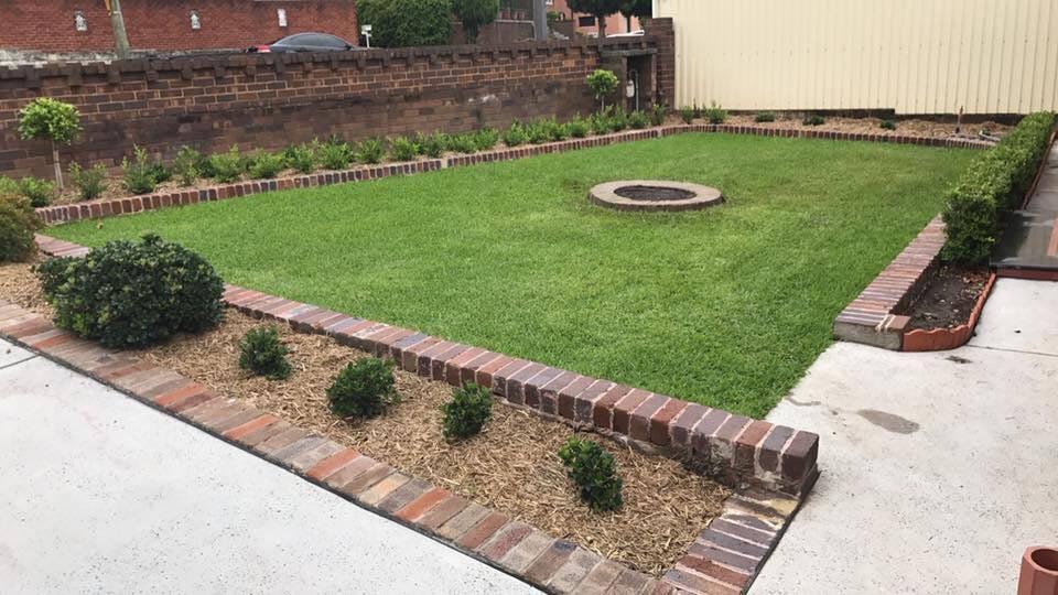 yard with low brick walls