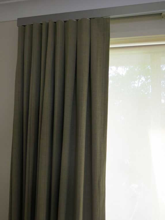 forest green curtain on window