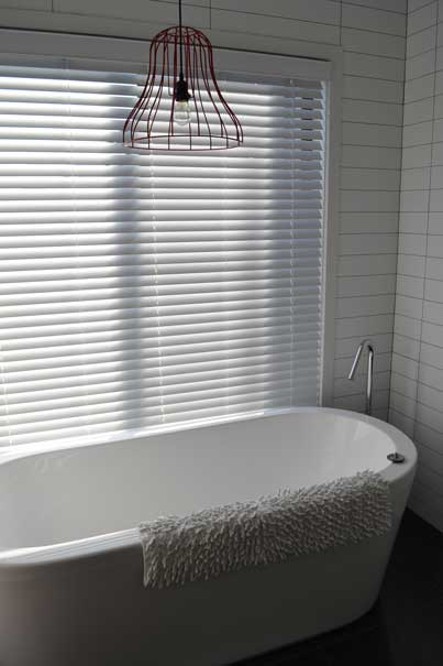 bath with rug on side
