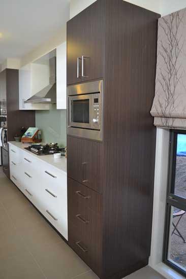 microwave near white kitchen