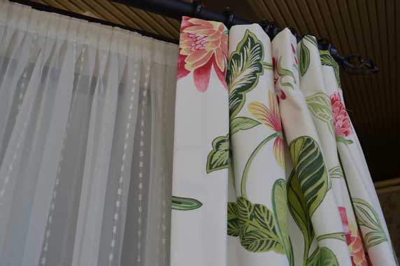 zoomed in floral curtain with white curtain