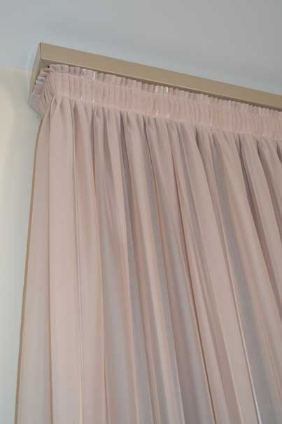pink curtain with design at the top