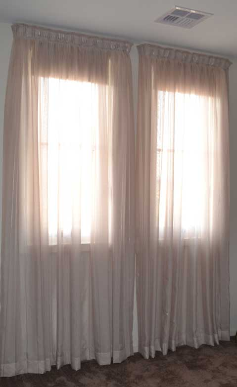 sheer curtains with sun shining