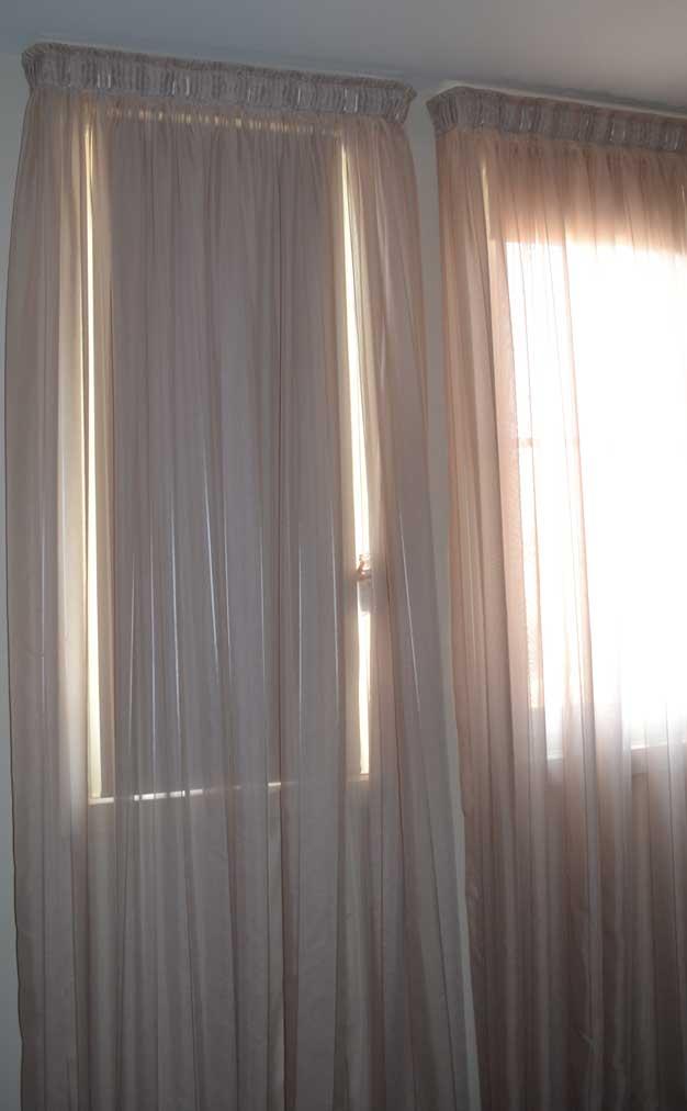 pink curtain near door