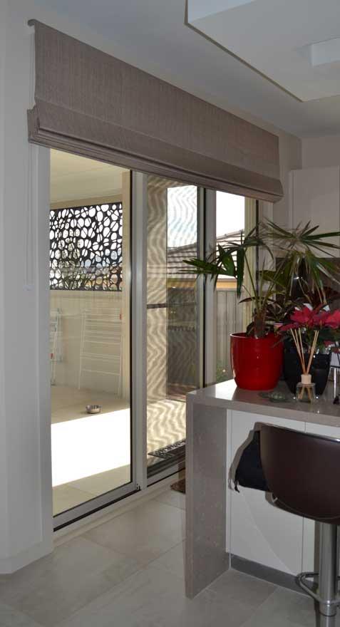 plants near window in red pot