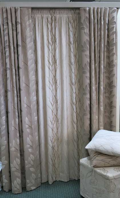 white pillow near brown curtains