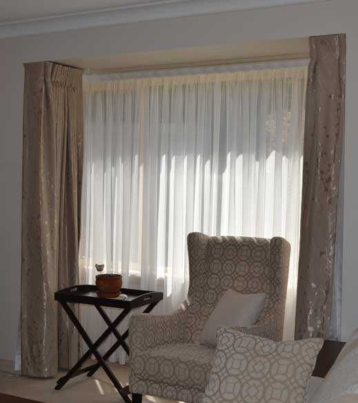 white shear curtains with brown curtains