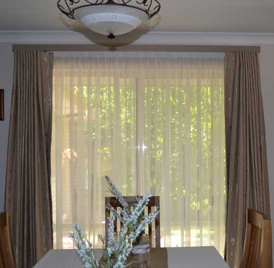 dining table near curtains