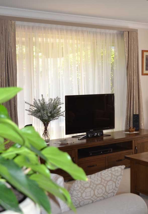 black tv near window