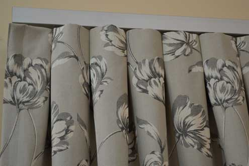 grey floral pattern curtain with creases