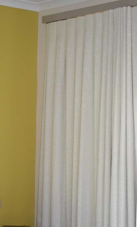 white curtain on bright yellow wall