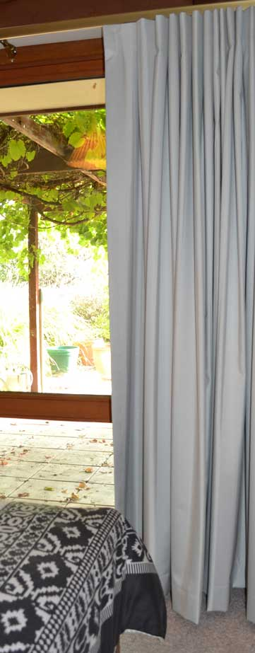 light grey curtain near window