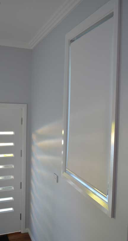 blinds with light flowing through