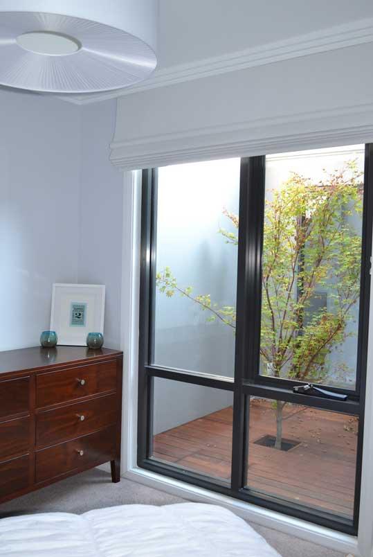 cherry red dresser near window
